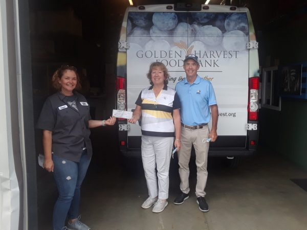 A check was presented to Golden Harvest Food Bank on behalf of the City Amateur Championship by co-chairs, Jim McNair (club owner) and Lorraine Morgan.  An amazing establishment feeding Aiken.
